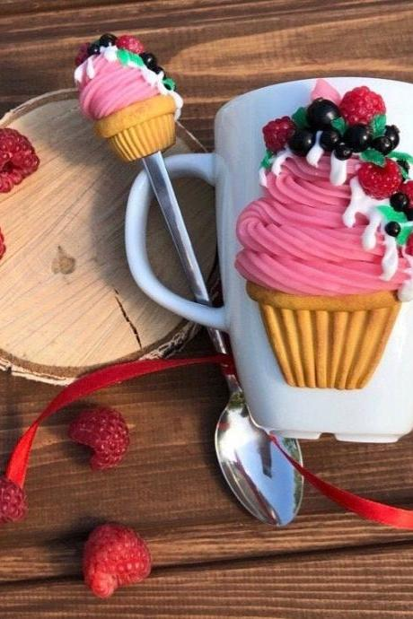 Sweet cupcake with berries on a mug, sweet spoon with cupcake, ice cream spoon, tea mug with decor, decorated mug, gift mug. Pink, White.